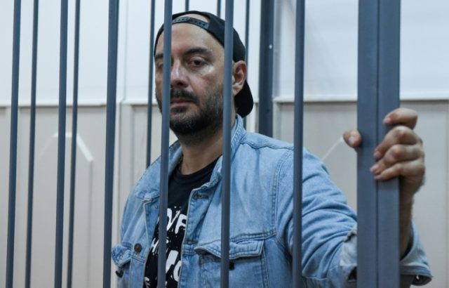 Charged with fraud, Serebrennikov looks on from inside a defendants cage during a hearing last August in a Moscow district court.