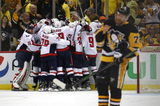 The Washington Capitals celebrate a 2-1 overtime win against the Pittsburgh Penguins to move into the Eastern Conference finals