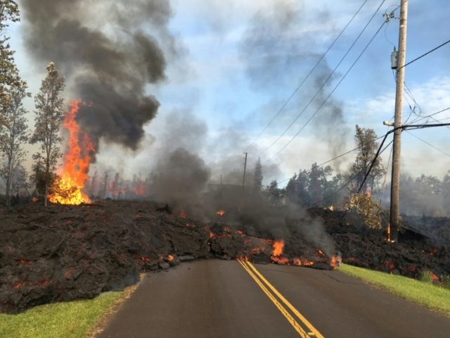 Lava covers a street in the Leilani Estates area in this image released by the US Geological Survey