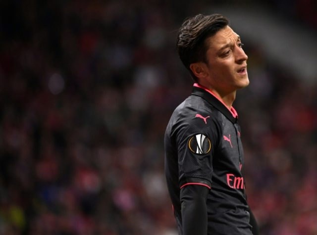 Down but not out: Ozil has vowed to be fit in time for Germany's World Cup defence