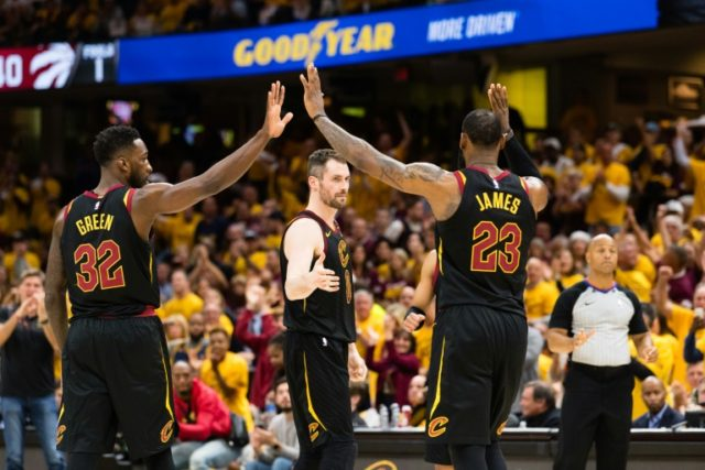 Jeff Green (L), Kevin Love (C) and LeBron James of the Cleveland Cavaliers celebrate as Cleveland demolished the Toronto Raptors 128-93 to seal a series sweep