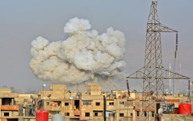 Smoke rises from buildings after regime strikes on the Palestinian camp of Yarmuk and the neighbouring Hajar al-Aswad district in southern Damascus, on May 1, 2018
