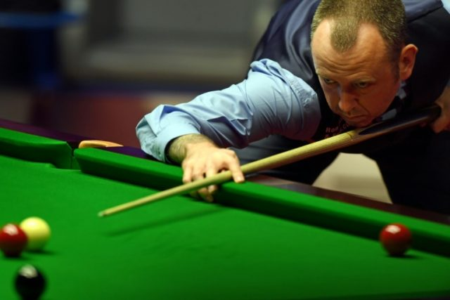 Wales's Mark Williams plays a shot against Scotland's John Higgins during the World Championship Snooker final match