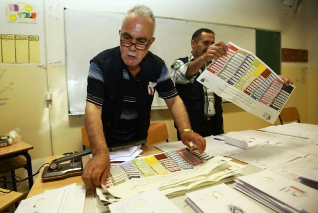 Lebanese officials count votes at a polling centre in Beirut after the country's first parliamentary elections in nine years