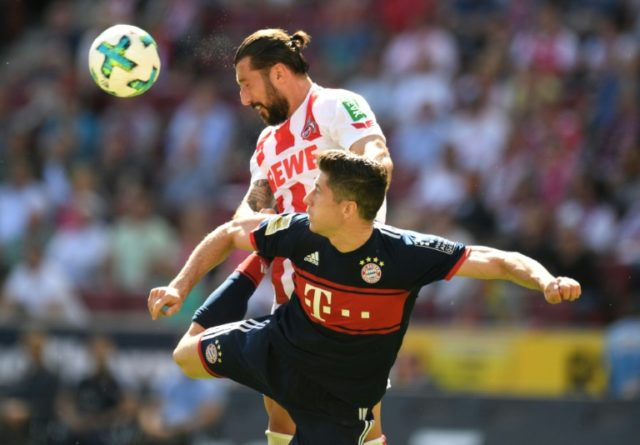 Bayern Munich forward Robert Lewandowski (bottom) on his way to his 150th goal for the club, and a stern ticking off afterwards
