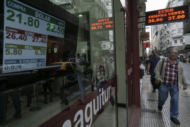 Argentina's peso stabilized Monday after a run on the currency last week prompted the central bank to intervene -- here, currency exchange values are seen Friday in the buy-sell board of an exchange center in downtown Buenos Aires