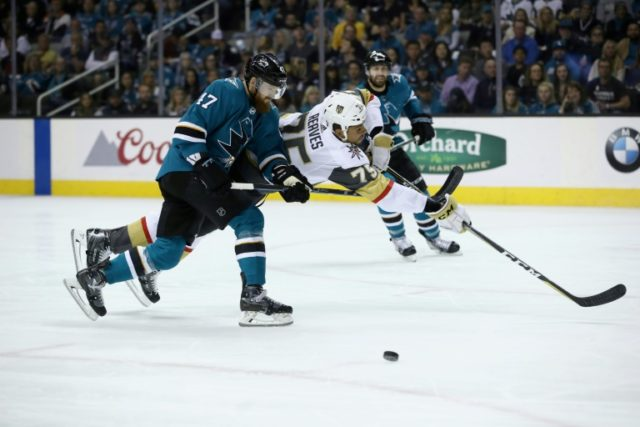 Ryan Reaves of the Vegas Golden Knights is sent flying by a hit from Joakim Ryan of the San Jose Sharks as Vegas advanced to the Western Confernce final with a 3-0 win
