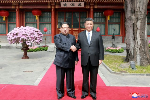 Kim Jong Un and Xi Jinping (pictured at their March meeting in Beijing) met in the northeast city of Dalian
