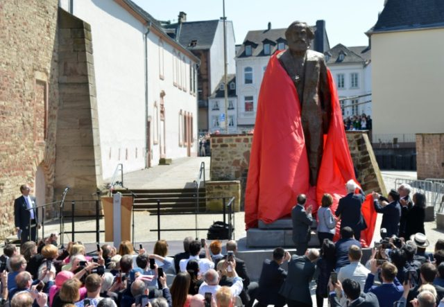 Visitors look on as a statue of German revolutionary thinker Karl Marx is unveiled in his native city