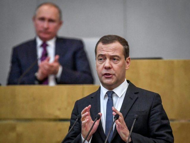 Prime Minister Dmitry Medvedev addresses the Duma,applauded by Putin