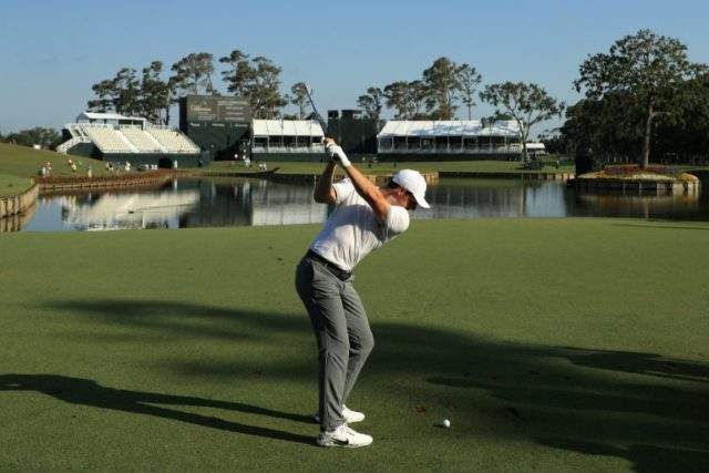 Rory McIlroy of Northern Ireland plays his shot from the 17th tee during practice rounds prior to the Players Championship at TPC Sawgrass