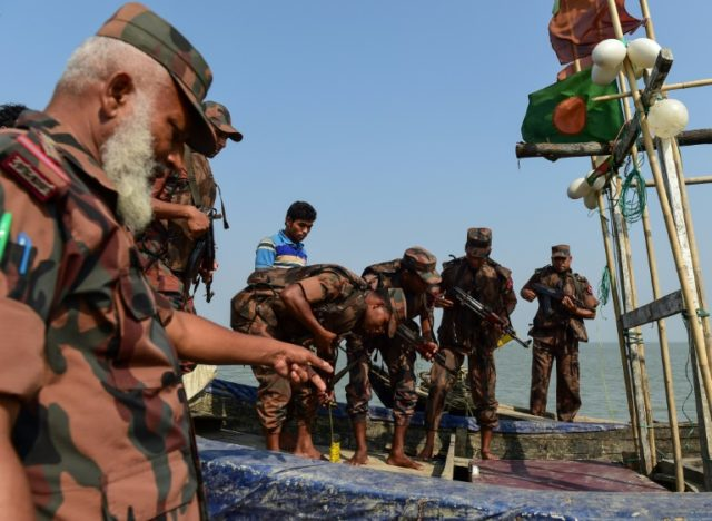 Bangladesh Border Guards search a fishing boat on the Naf River in Teknaf, a key trade route for the meth tablets that are flooding into Bangladesh through the Rohingya refugee camps