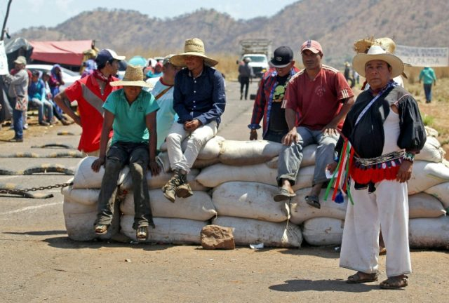 Members of Mexico's indigenous Wixarika communities block a road during a protest over land rights in Jalisco State