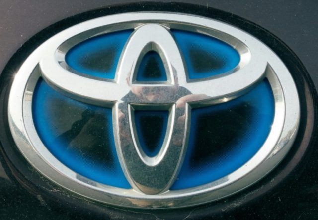 Toyota warned profits would drop 15 percent this year and said the auto industry was facing a moment of 'profound transformation'
