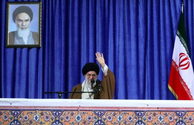 A handout picture provided by the office of Iran's supreme leader on May 9, 2018 shows Ayatollah Ali Khamenei waving to a crowd as he delivers a speech