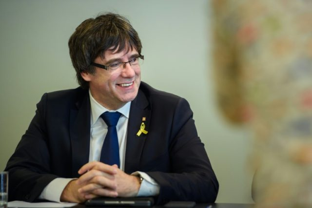 "Catalonia's ousted leader Carles Puigdemont attends a meeting with members of the Catalan political platform ""Junts per Catalunya"" in Berlin on April 18, 2018"