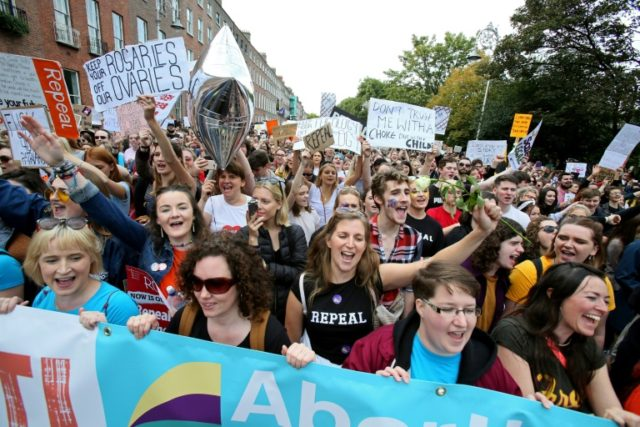 Protesters hold up placards as they take part in the March for Choice, calling for the legalising of abortion in Ireland after the referendum announcement, in Dublin on September 30, 2017