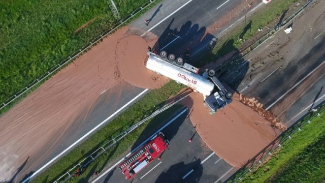 Chocolate poured out over the A2 highway between Wrzesnia and Slupca near Poznan, western Poland, after the truck crashed, seen here in a video grab from the Polish private TVN channel