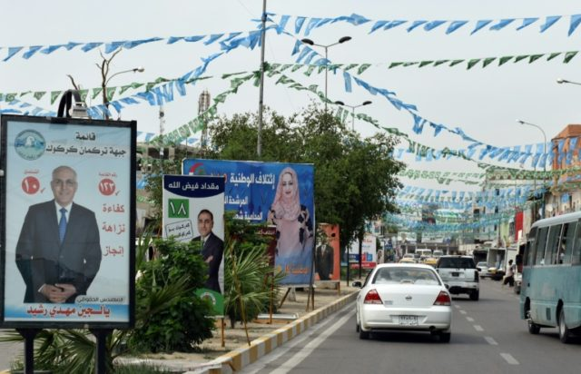 Electoral campaign posters are seen on May 8, 2018 in the Iraqi city of Kirkuk