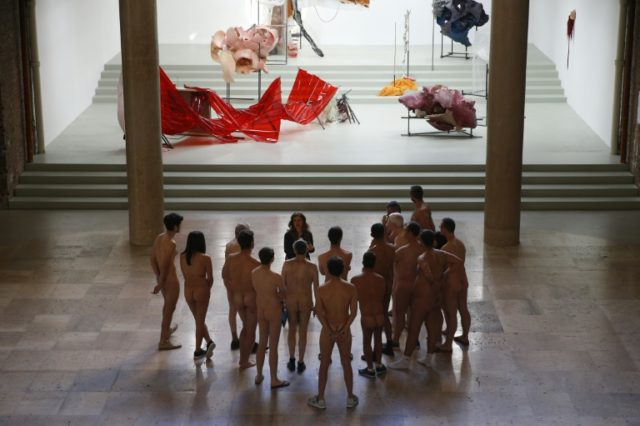 Nearly 200 men and women seized their chance for a private, clothes-free visit at the Palais de Tokyo museum in Paris on May 5