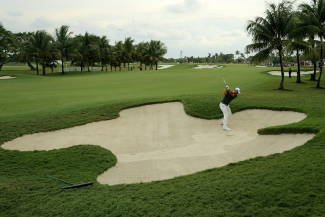 Adam Scott of Australia out of the bunker on the 14th hole during the third round of the World Golf Championships-Cadillac Championship at Trump National Doral Blue Monster Course on March 5, 2016 in Doral, Florida