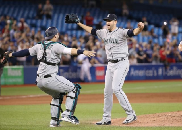 James Paxton of the Seattle Mariners is congratulated by Mike Zunino (L)after throwing a no-hitter against the Toronto Blue Jays, only the second Canadian in MLB history to do so