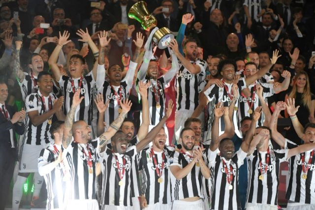 Juventus players celebrate with the Italian Cup after beating AC Milan 4-0 in Rome