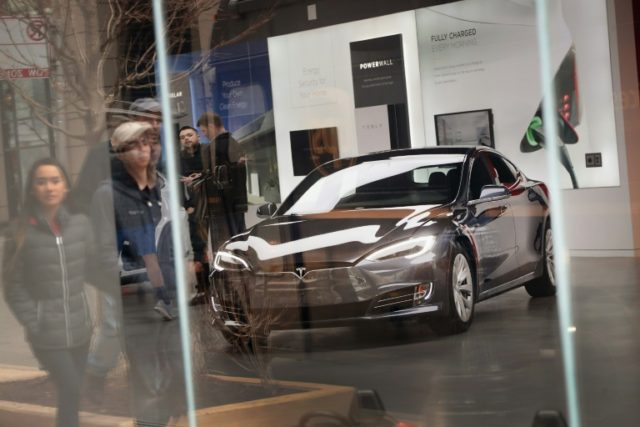 A Model S sits on the showroom floor at a Tesla dealership on March 30, 2018 in Chicago, Illinois; esla was reportedly traveling at high speed when it hit a wall then caught fire, killing two people and injuring a third