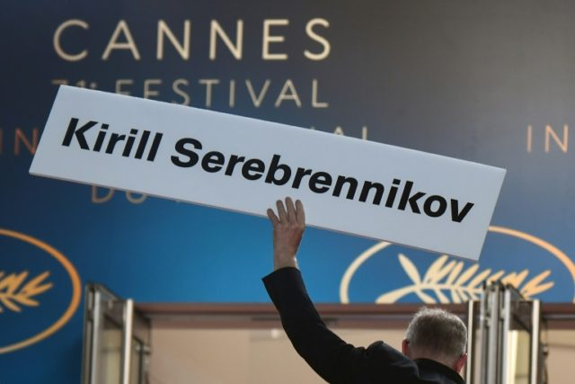 """The General Delegate of the Cannes Film Festival Thierry Fremaux holds a cardboard bearing the name of Russian director Kirill Serebrennikov ahead of the screening of his film """"Leto (Summer)"""". He is under house arrest in Moscow and barred from attending the film festival."""