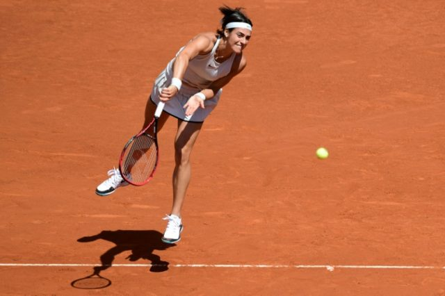 France's Caroline Garcia returns the ball to Spain's Carla Suarez Navarro during their WTA Madrid Open quarter-final in Madrid