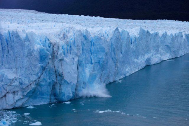 A chunck of ice falls from the Perito Moreno Glacier, at Los Glaciares National Park, near El Calafate in the Argentine province of Santa Cruz, on March 10, 2018