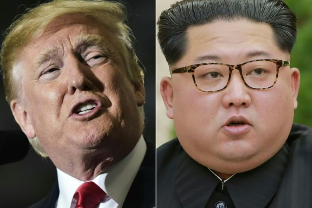 US President Donald Trump says he will meet with North Korea's Kim Jong UN (R) June 12 in Singapore