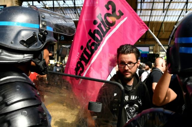 Rail unions squared off against police during a protest at the Gare du Nord station in Paris on Monday against the government's reform plan for the rail operator SNCF