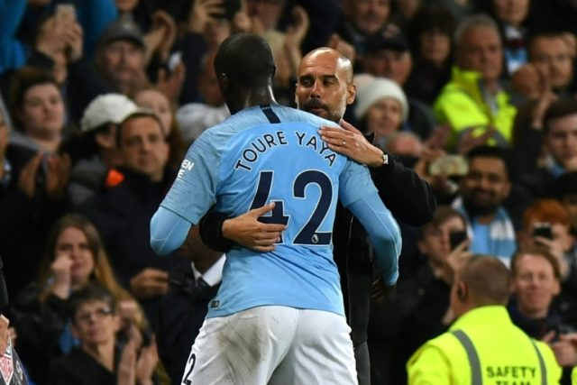 Manchester City manager Pep Guardiola embraces midfielder Yaya Toure as he is substituted during the Premier League football against Brighton