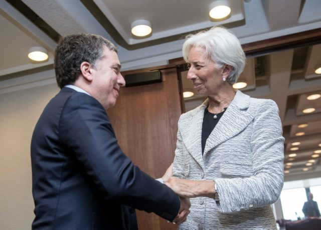 International Monetary Fund chief Christine Lagarde greets Argentinian Economy Minister Nicolas Dujovne prior to talks at IMF headquarters in Washington, DC, on May 10, 2018