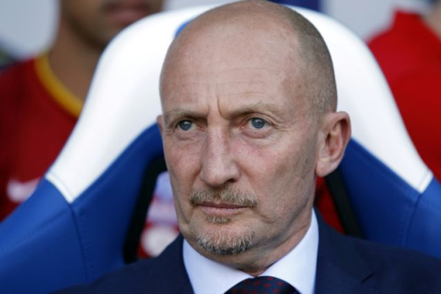 Crystal Palace's manager Ian Holloway waits for kick off before the English Premier League football matchagainst Sunderland at Selhurst Park in south London on August 31, 2013