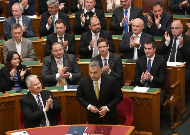 Hungarian Prime Minister Viktor Orban (C) is sworn in at parliament in Budapest