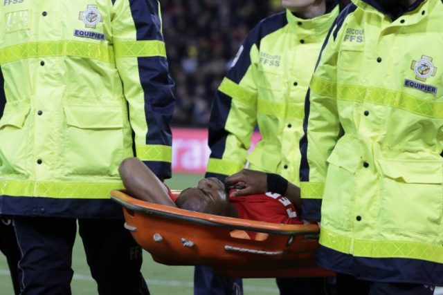 Monaco's French defender Djibril Sidibe is brought off the field in a stretcher after an injury during the French L1 football match against Paris Saint-Germain April 15, 2018, at the Parc des Princes stadium in Paris