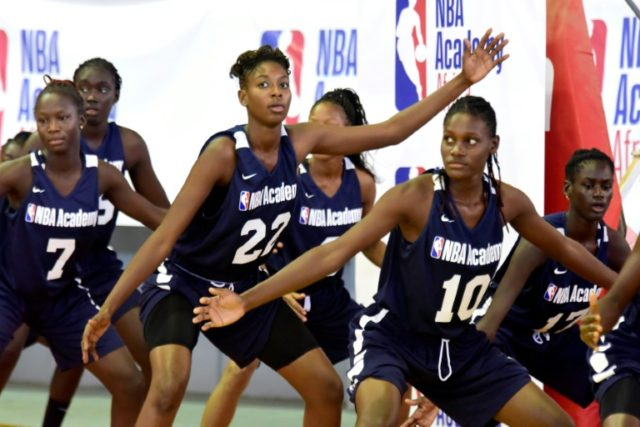 Young African women participate in the NBA Academy basketball camp at Maurice Ndiaye Stadium in Dakar