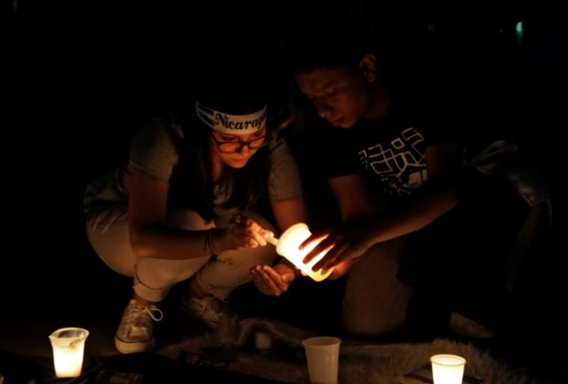 Students light a candle to mourn after deadly protests in Nicaragua, triggered by an aborted attempt to reform the national social security system, but quickly expanded to include grievances against President Daniel Ortega