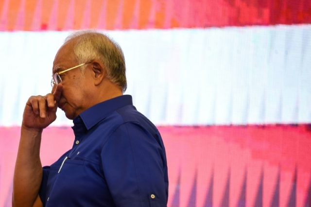 Malaysia's scandal-mired Najib on the ropes after shock loss