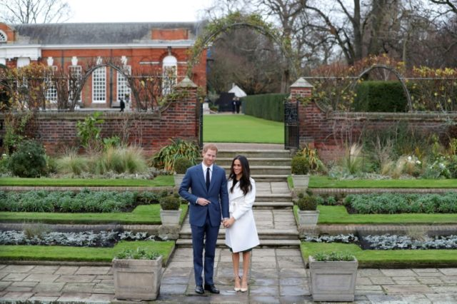 Britain's Prince Harry and his fiancée US actress Meghan Markle in the Sunken Garden at Kensington Palace in west London, following the announcement of their engagement in November. The palace which hosts many royals will also be their marital home.