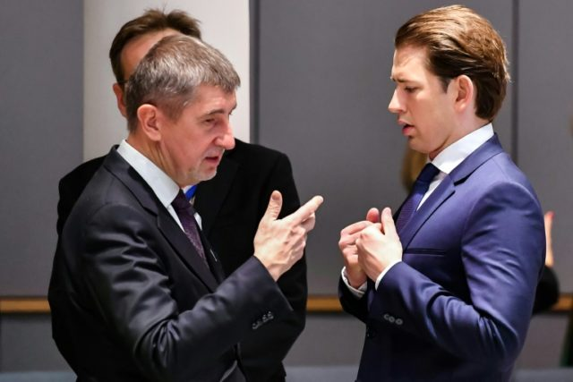 Czech Prime Minister Andrej Babis, seen meeting Austria's Chancellor Sebastian Kurz at a March EU summit, said a raft of compromises had been necessary to thrash out a coalition deal with Social Democrats with informal Communist support