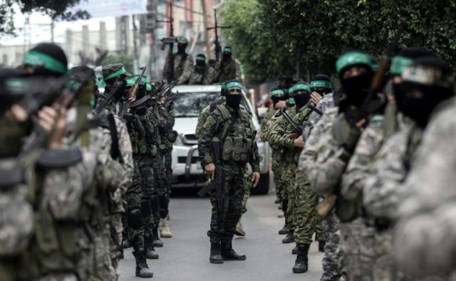 Fighters from the Ezzedine al-Qassam Brigades, the armed wing of the Palestinian Hamas movement, take part in a military show ahead of the 30th anniversary of the movement's founding in the southern Gaza city of Khan Yunis on December 5, 2017