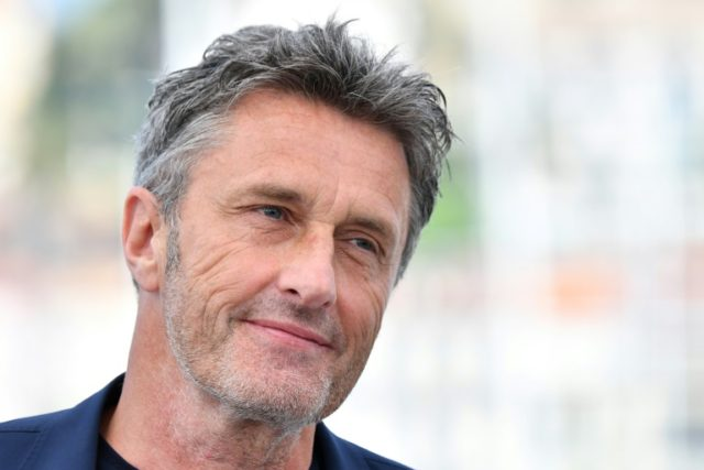"""Polish director Pawel Pawlikowski poses on May 11, 2018 during a photocall for the film """"Cold War (Zimna Wojna)"""" at the 71st edition of the Cannes Film Festival in Cannes, southern France"""