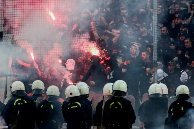Trouble spot: PAOK fans throw flares towards police