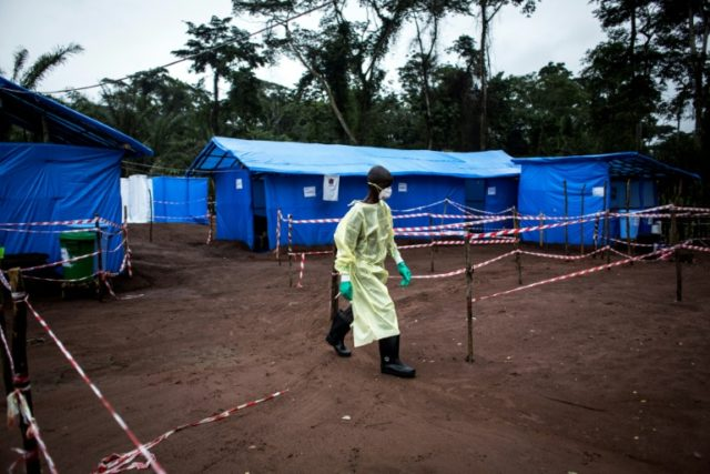 This file photo taken last year in DR Congo shows healthcare workers at an Ebola quarantine unit in Muma, after a case of Ebola was confirmed in the village. A fresh outbreak of the disease in Bikoro since April has so far claimed 18 lives