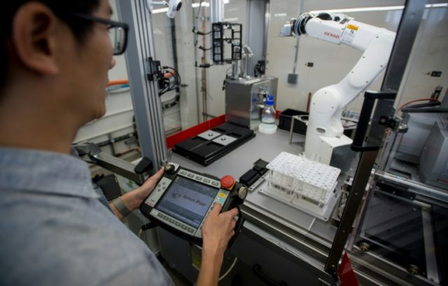 An engineer for Just uses a robotic arm at the company's headquarters office in San Francisco on May 4, 2018; the firm recently started to work on a new kind of meat based on animal cells