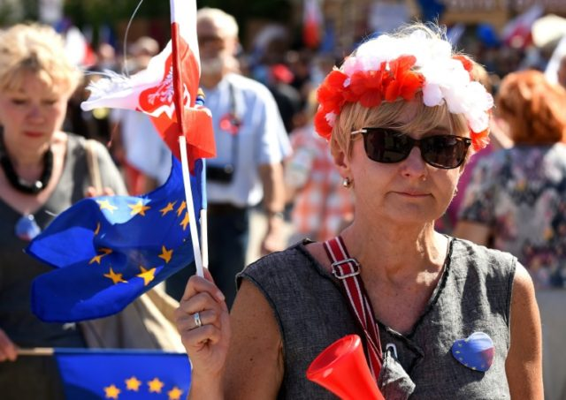 "Protesters decked themselves out in patriotic colours and also brandished EU flags at their ""Freedom March"" against the right-wing government, saying its policies are leaving them isolated in Europe"