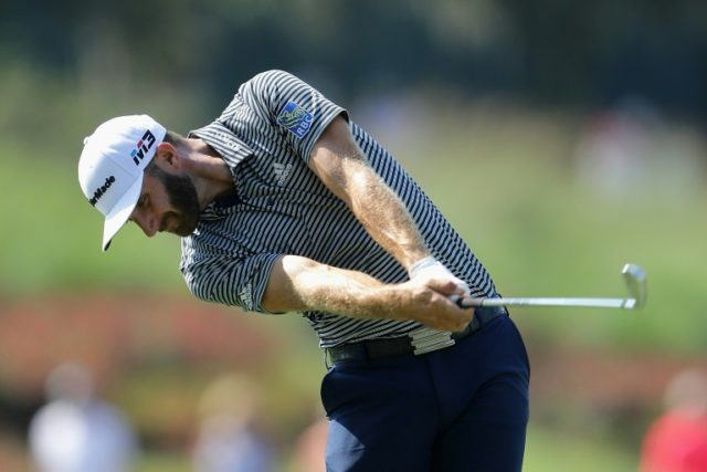 Dustin Johnson of the United States plays a shot on the 18th hole during the first round of The Players Championship on the Stadium Course at TPC Sawgrass on May 10, 2018 in Ponte Vedra Beach, Florida